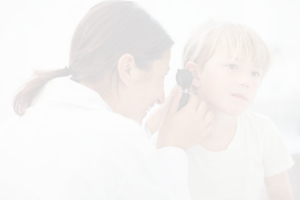 A doctor looking in a young childs ear
