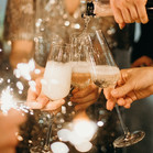 person-pouring-champagne-on-champagne-fl