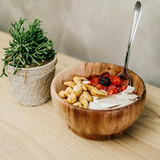 sliced-berries-and-cashews-in-wooden-bow
