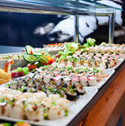 sushi-on-white-plates-on-brown-wooden-ta