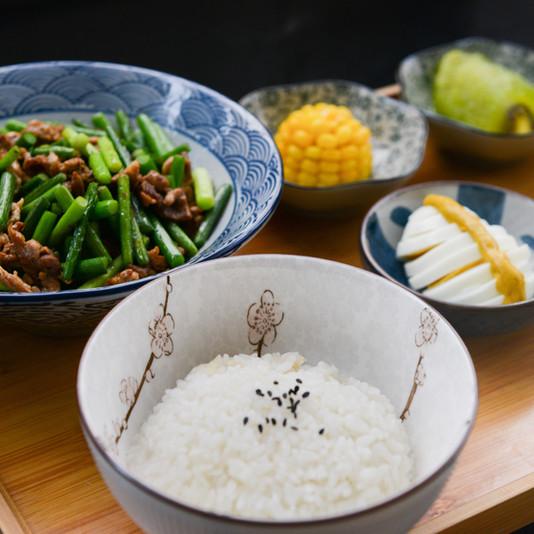 rice-on-bowl-sliced-egg-corn-and-vegetab
