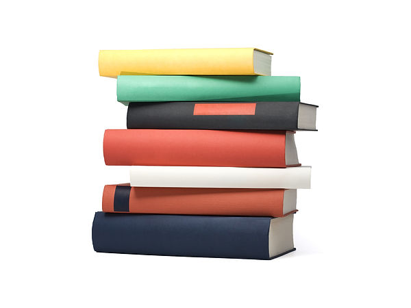 stack of seven books in various colors a