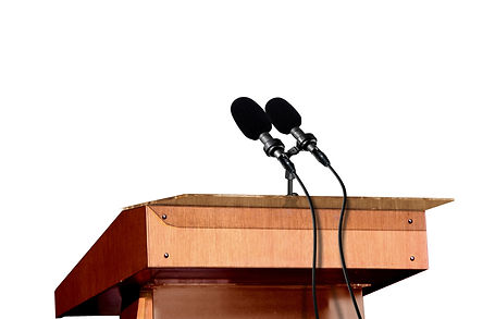Microphones on the podium over white.jpg