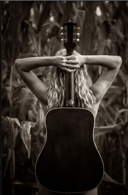 guitar on back - cornfield