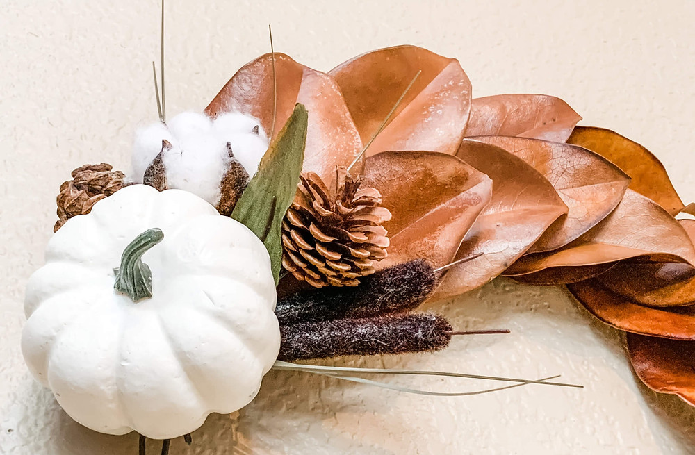 cotton floral with white pumpkin on leaves