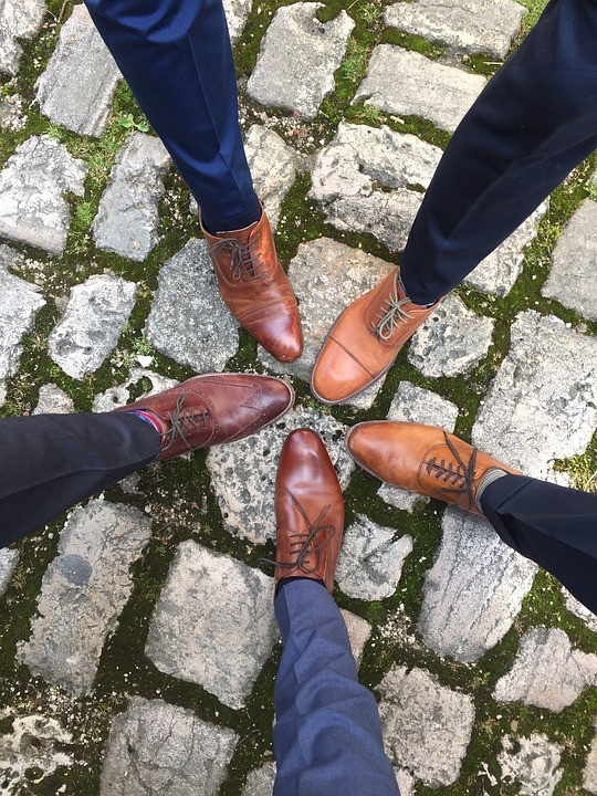 Men with same brown shoes