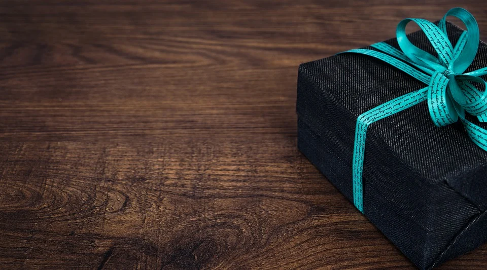 black gift box in a wooden table