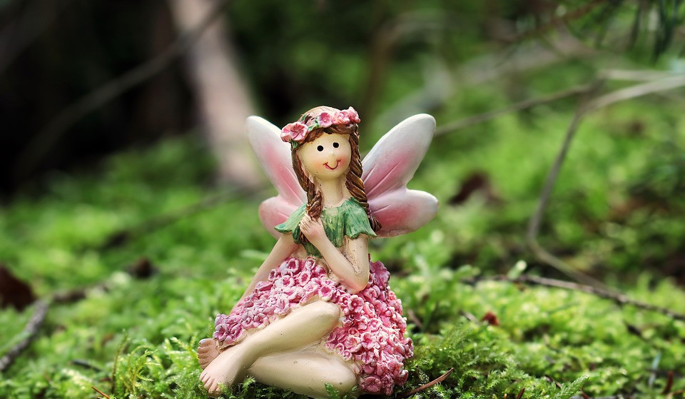 Clay fairy in a forest