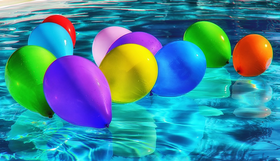 Colorful balloons in a pool