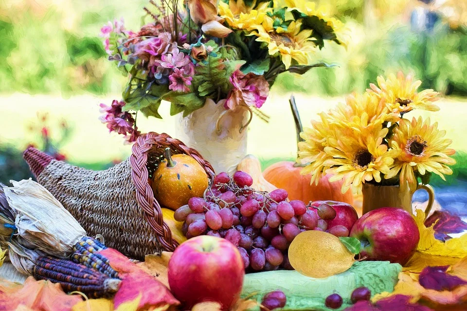 Table with fruits and flowers on top