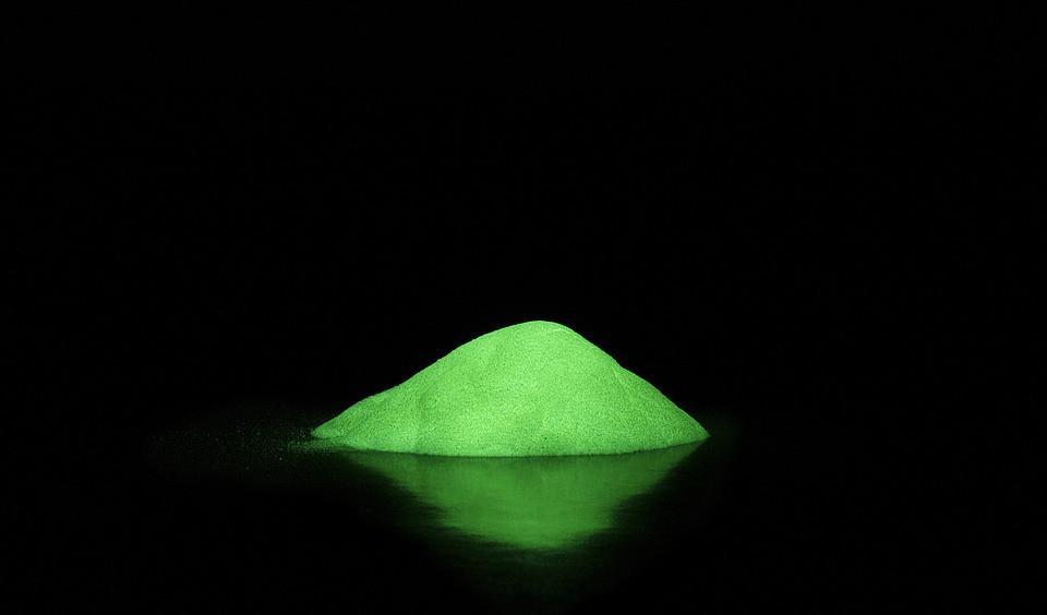 Fluorescent dust glowing in the dark
