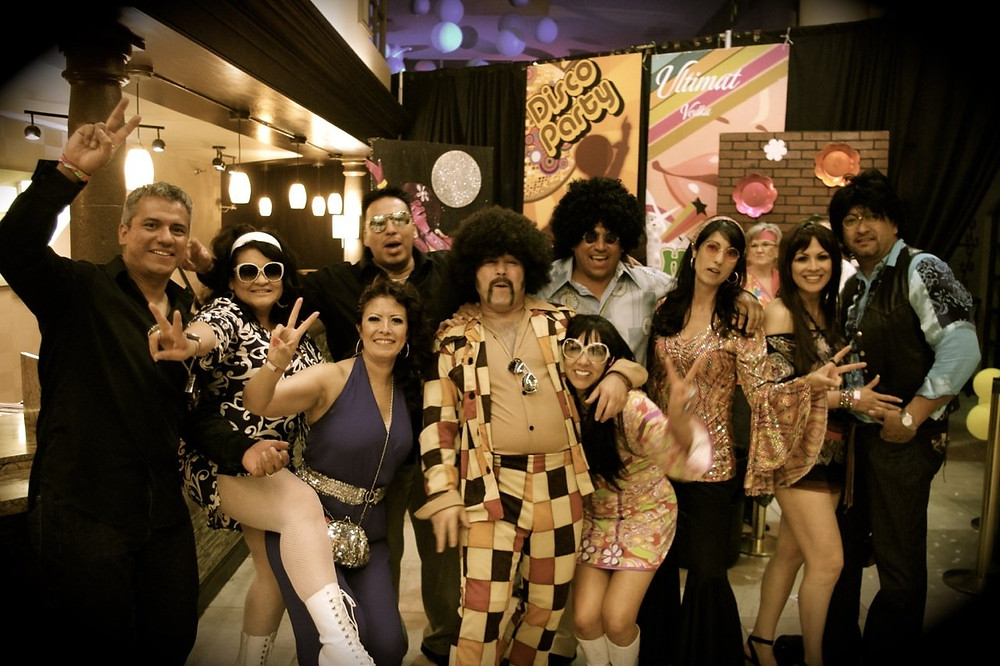 70's themed party with people with costumes
