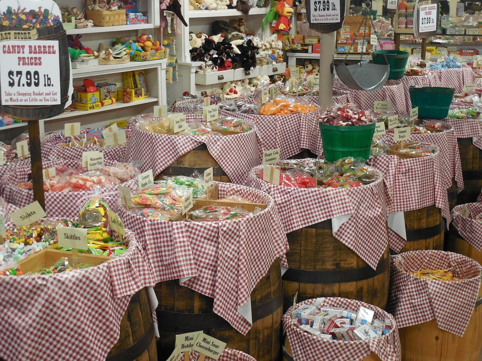 Candy bar with a lot of candy filled barrels