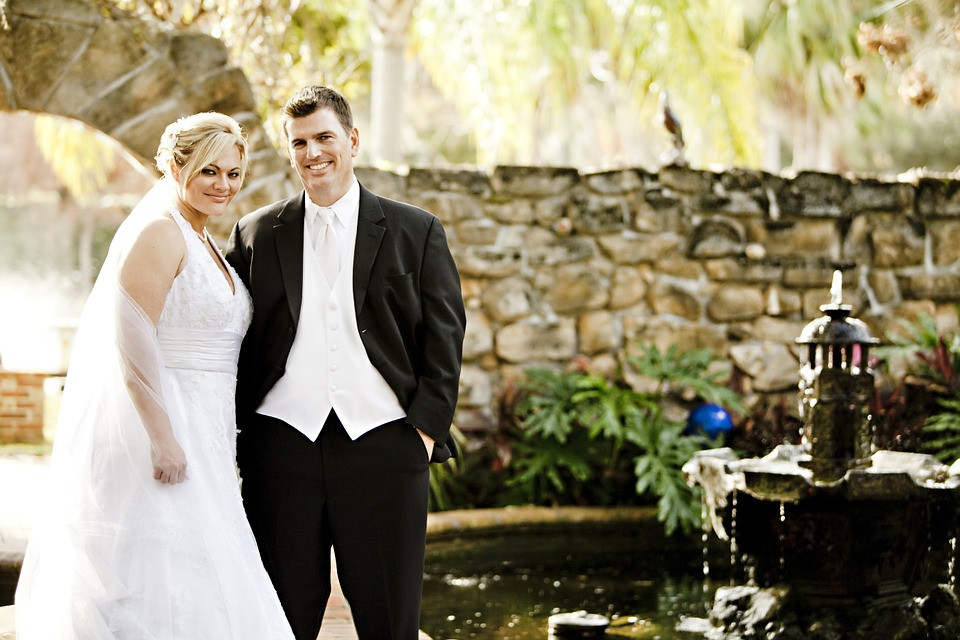 Bride and groom smiling at the camera