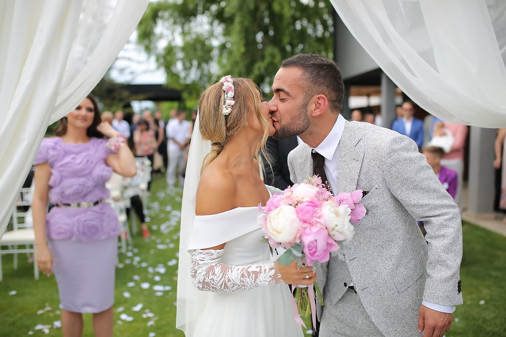 Bride and groom kissing in their wedding