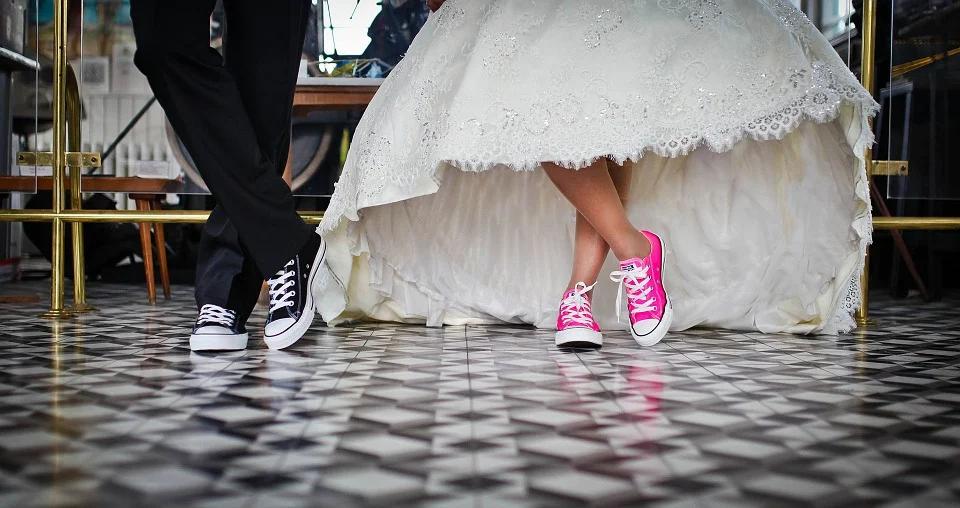 Bride and groom wearing vans