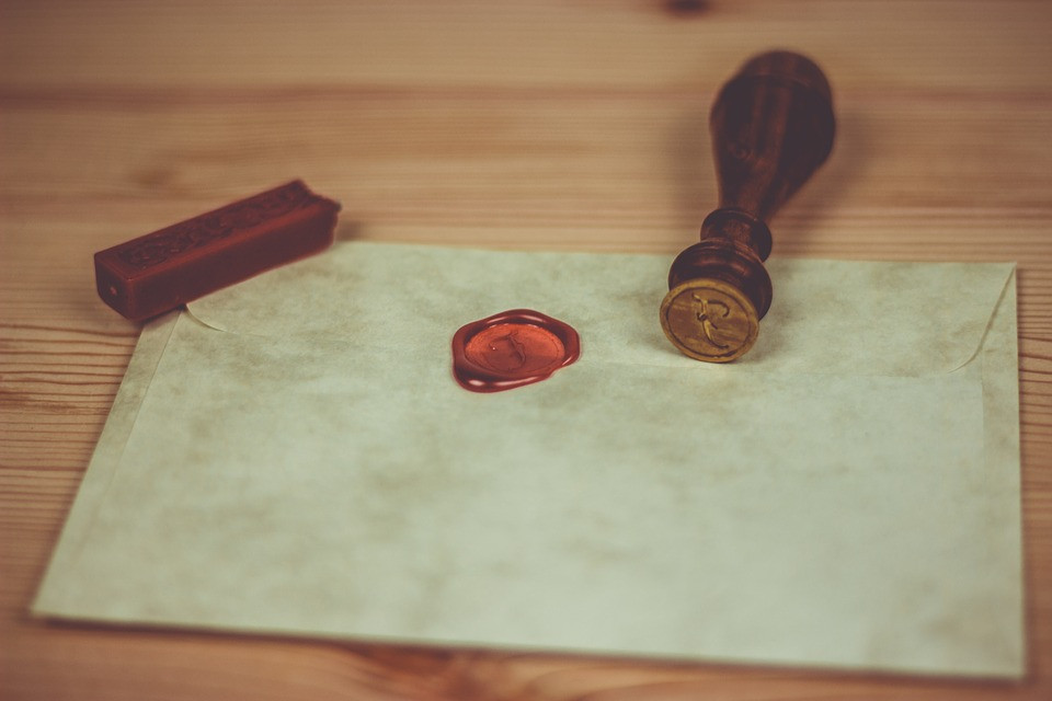 Red wax seal in a letter