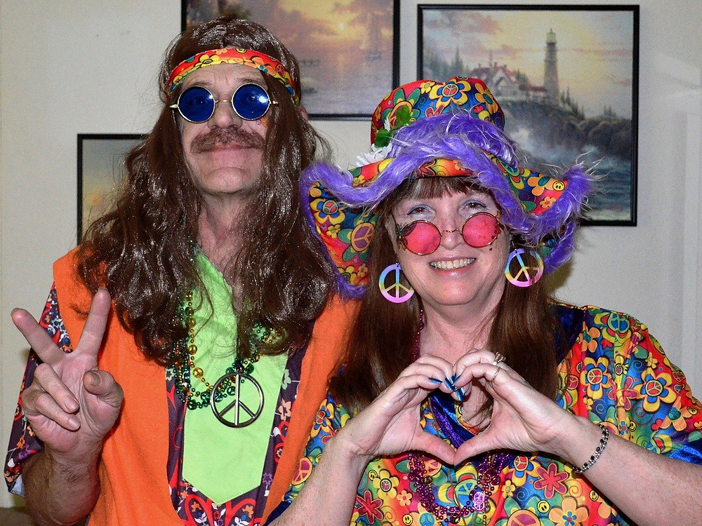 Two people dressing as hippies