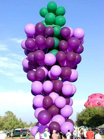 Balloons grape shaped floating in the air