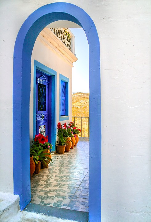 Blue doorway with a beautiful view in the other side