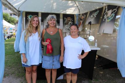 (L-R) DCAC Gallery Manager Tiffany Lindsey, NWFA Third Place Award Recipient Barbar Umbel,