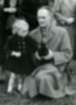 Thoralby Village Green: Elizabeth Scarr and her dad 'Jiff' with a hen bought for her 15 Oct., 1953
