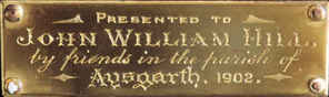 Brass plaque on John Williams clock, 190