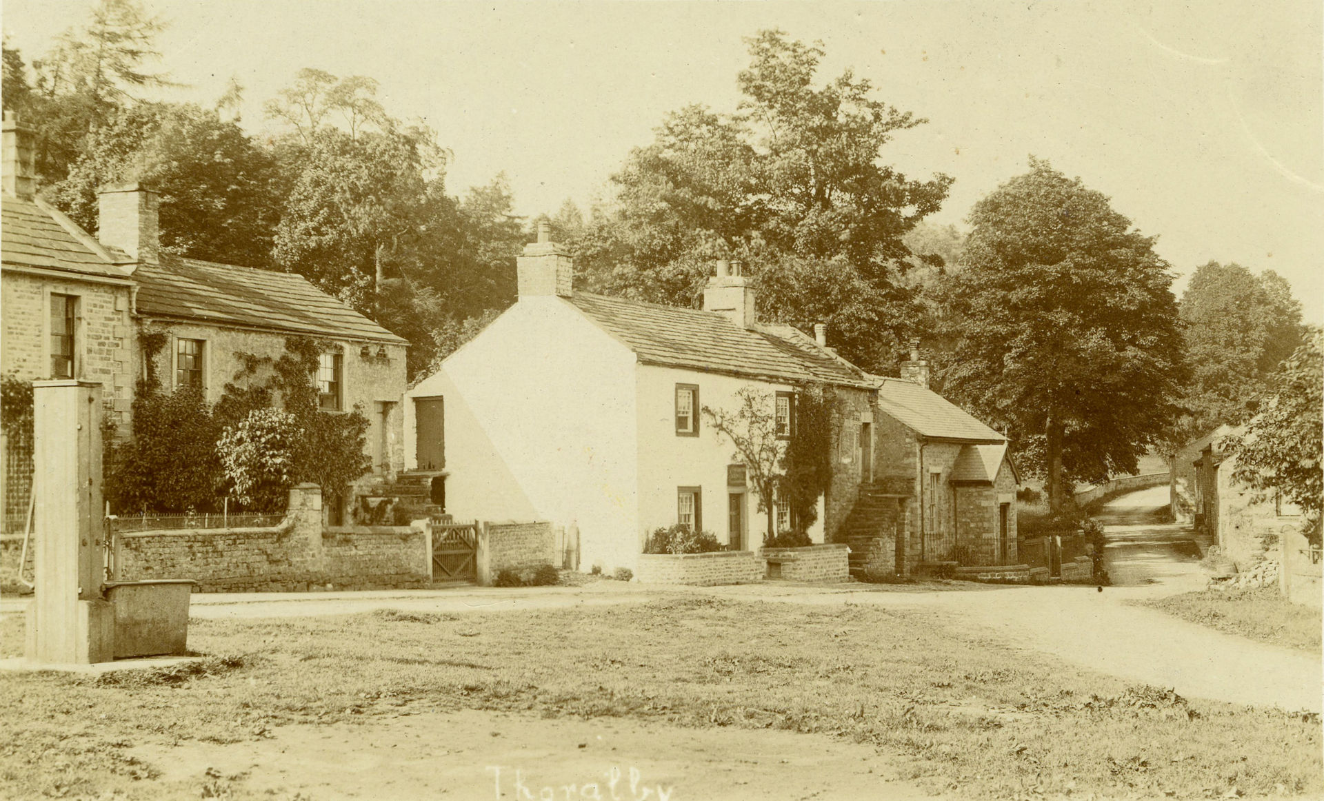Thoralby village green water pump, shop, and Reading Room, c.1904.