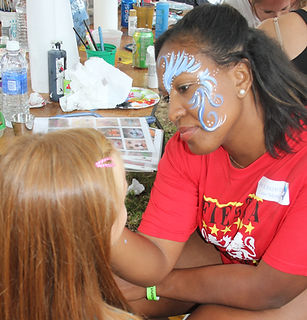 Woman facepainting kid