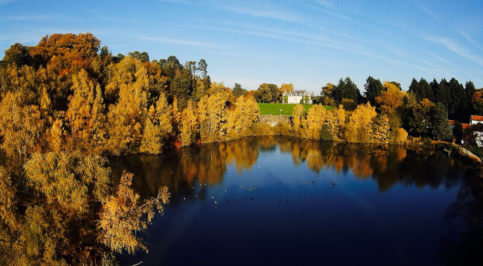Drone Aerial photo of Chateau across a lake
