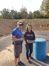 Happy father and daughter on the range in their range equipment.