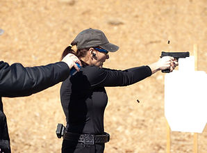 Lady sighting in on target during a competition