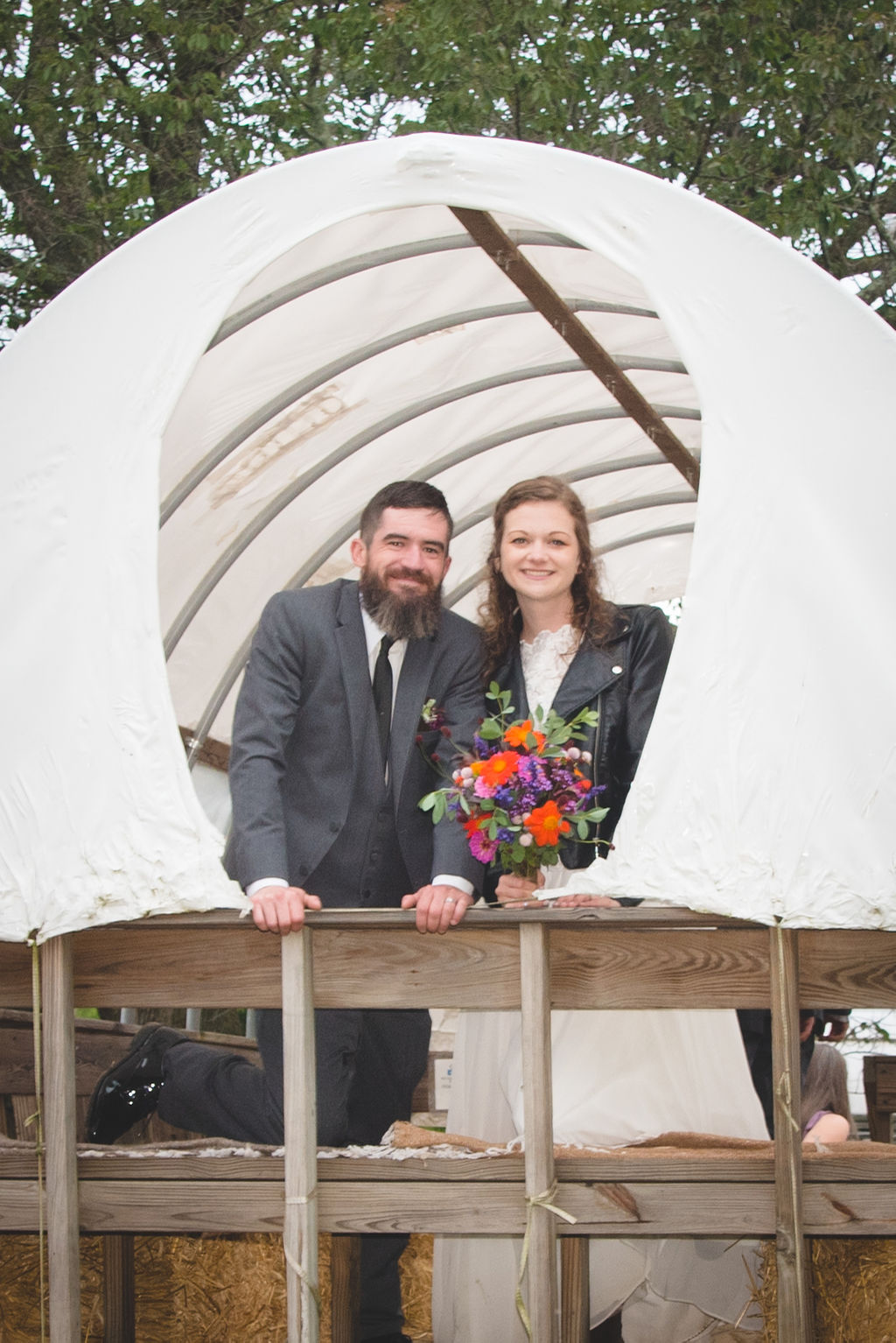 Bride & Groom on Covered Wagon