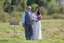 Bride and Father Walking in Field