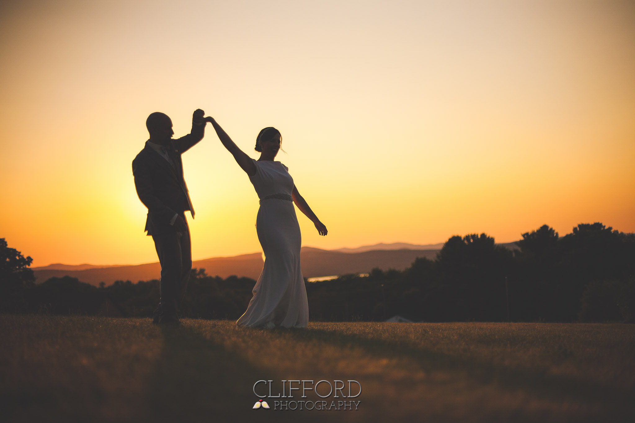 Dancing Bride and Groom at Sunset