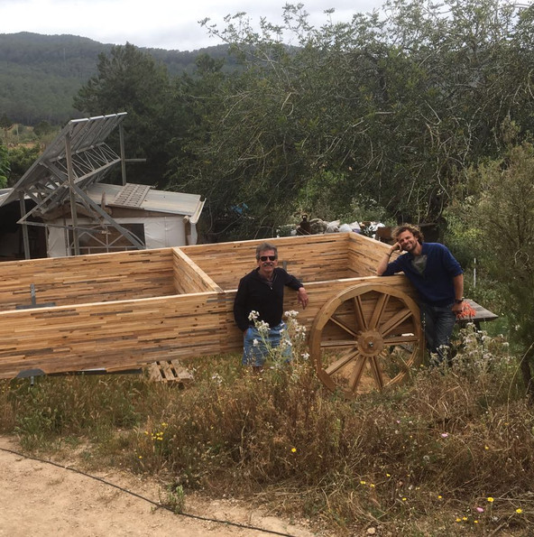 The base of the wagon is wheeled into place. The wheels are real and really move