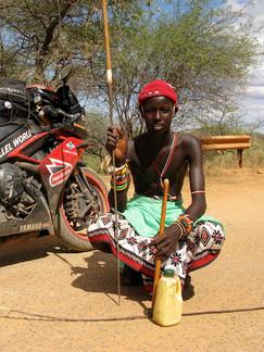 Young shepherd with bike.JPG
