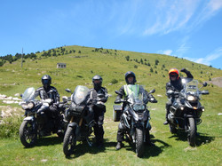 Group of riders at the top of the Pyrenees