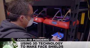 High school teachers using 3D technology to make face shields