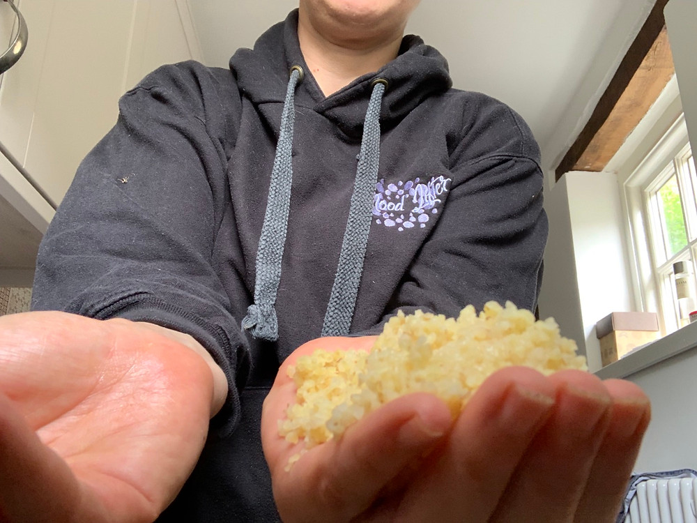 A cupped hand portion of bulgar wheat