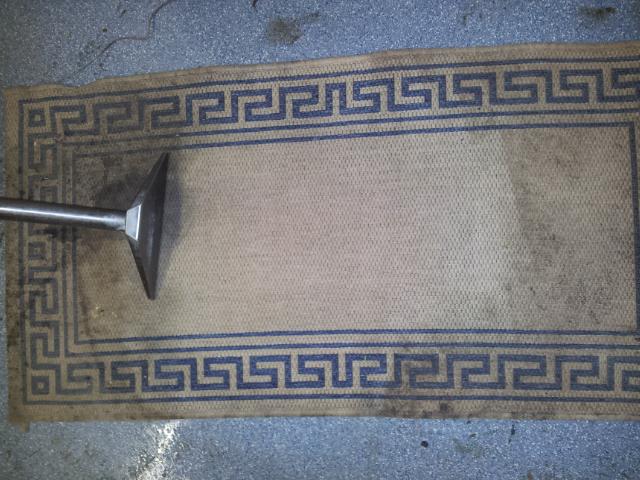 Soiled workman's rug