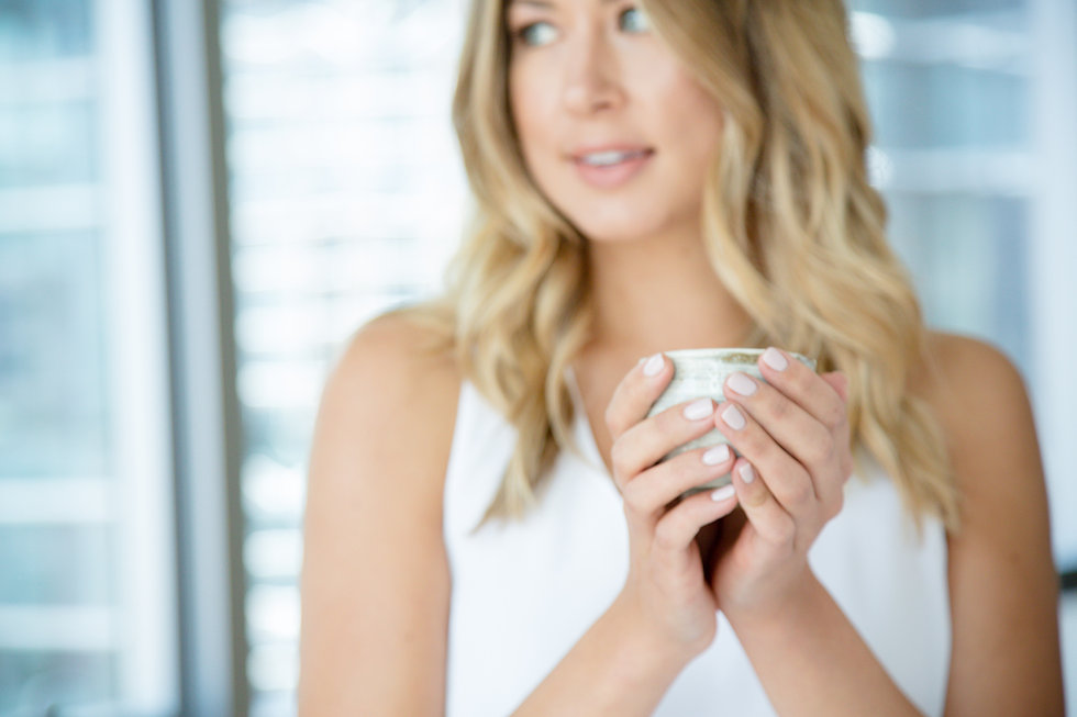 Woman holding cup of Sage Tonic hot tea