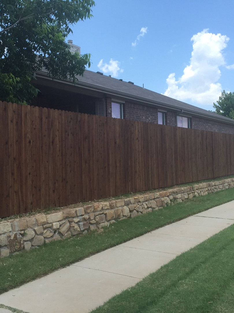 Dark Brown, Side by Side Cedar Fence with Stone Retaining Wall