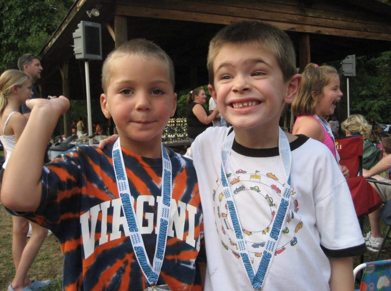 "Coach Parker & Coach Miles  enjoying their ""first 25 M"" medals at the end of the season picnic  Summer 2007"