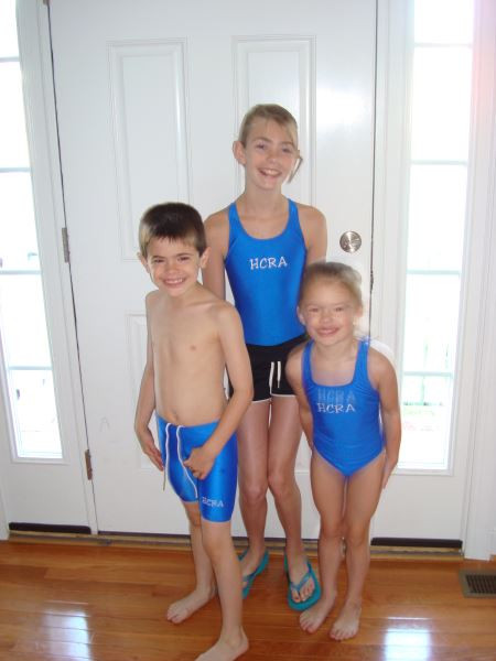 Coach Kelsey & Coach Miles-  with thier little sister Lydia- getting ready for a big meet!  Summer 2010