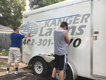 Lawn care job installing decals on lawn care trailer in Lincoln, NE