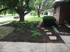 A clean, crisp landscaping bed before fall leaves need to be removed.