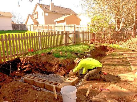 Outdoor job installing a retaining wall in Omaha, NE
