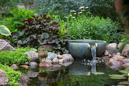 Spillway bowls are a great decorative fountan water feature element to break up pond edges, or have as stand alone water feature in your Omaha landscaping beds.