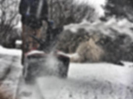 Kanger Lawns worker removing snow from Lincoln, NE resident's house.